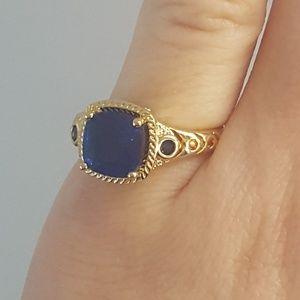 Elegant Gold Ring w/ Blue Jewel